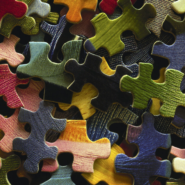 Pile of colorful puzzle pieces