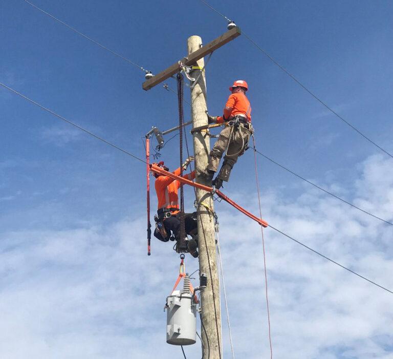 Hydro worker on a hydro pole