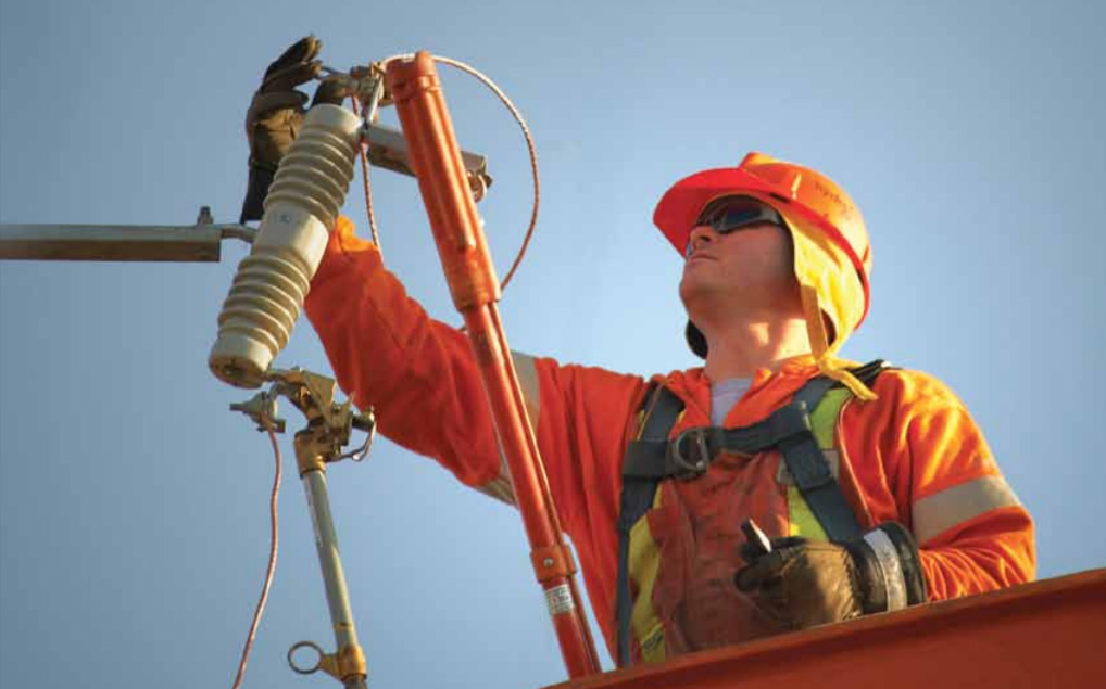 Worker working on electrical lines