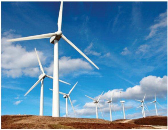 WInd farm with bright blue sky in the background