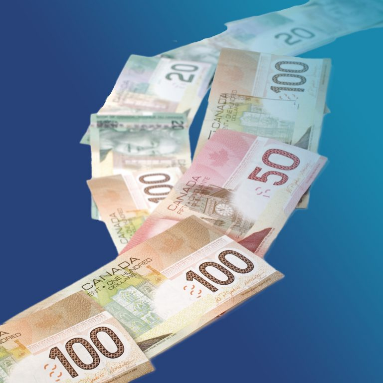 Canadian money on a blue background