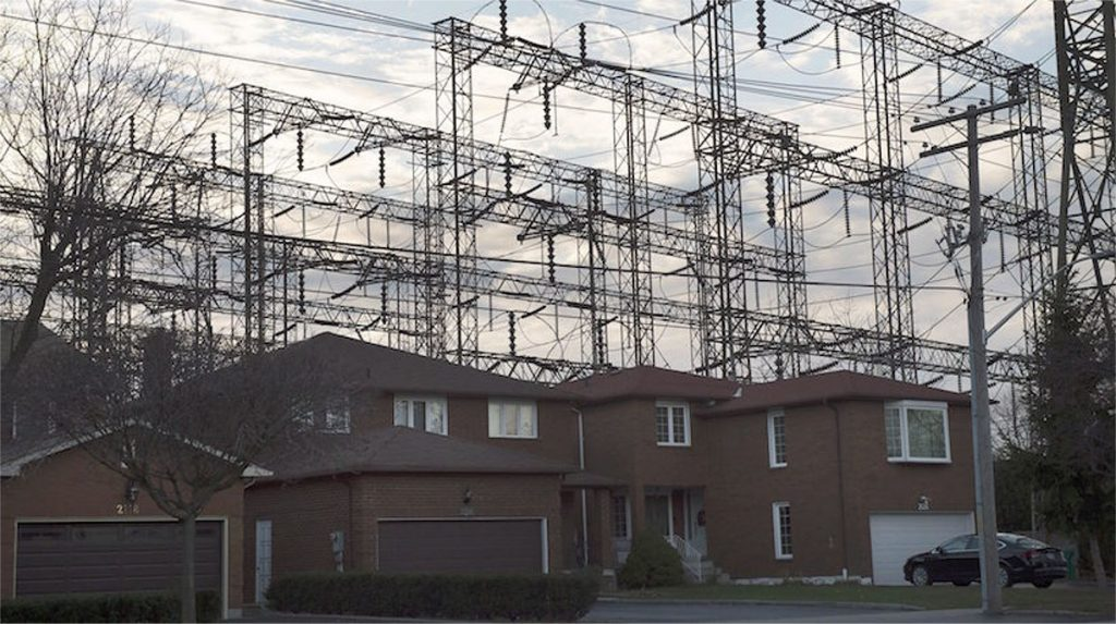 Electrical towers behind houses