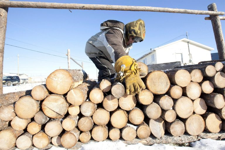 Many homes in remote Indigenous communities rely on wood or diesel for heating. THE CANADIAN PRESS/Adrian Wyld