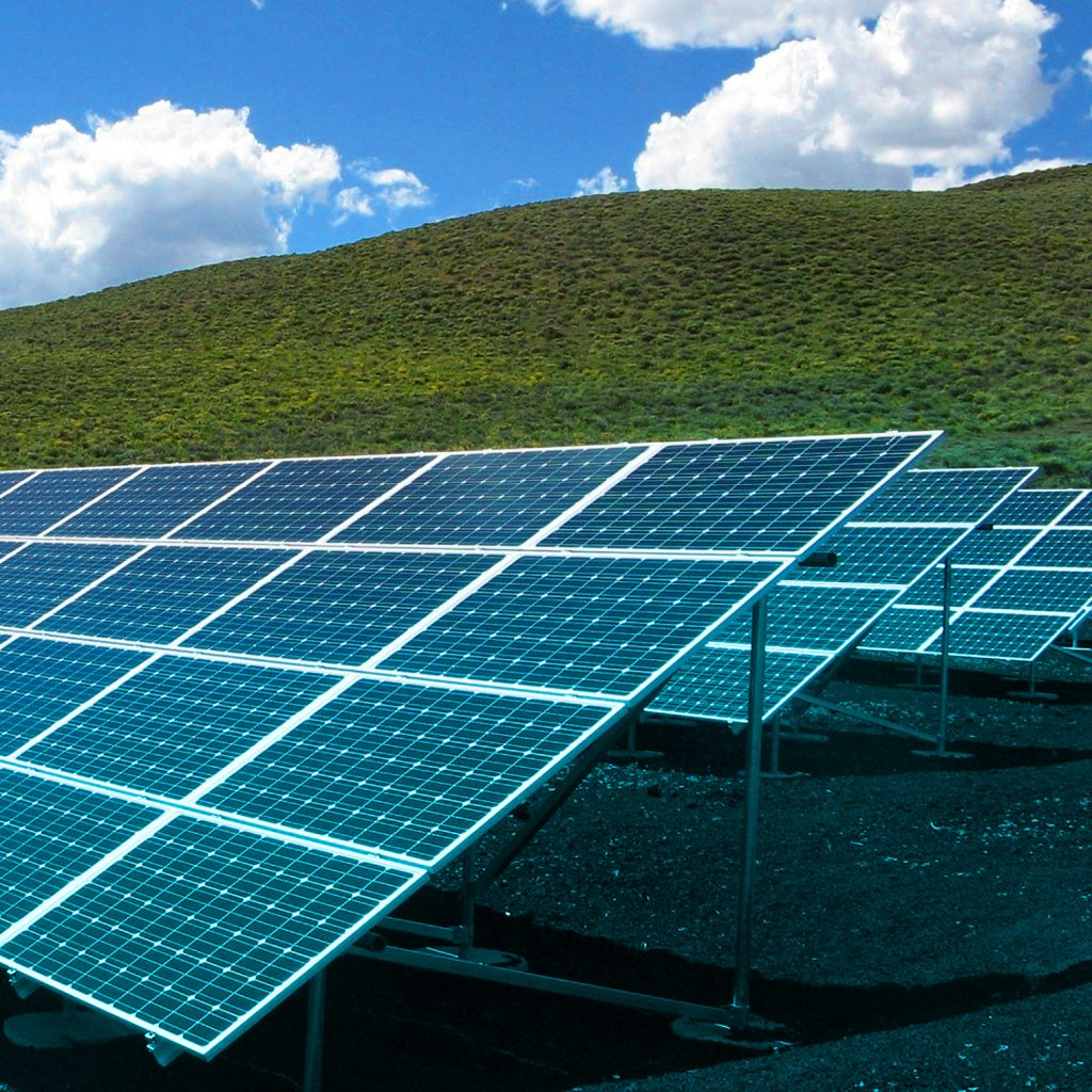 Solar panels on a grassy hill