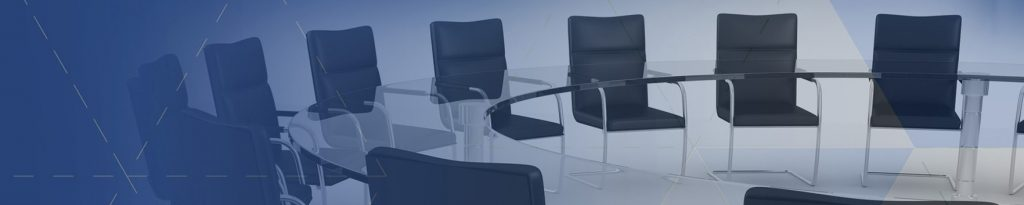 Office chairs arranged around a round table for discussion.