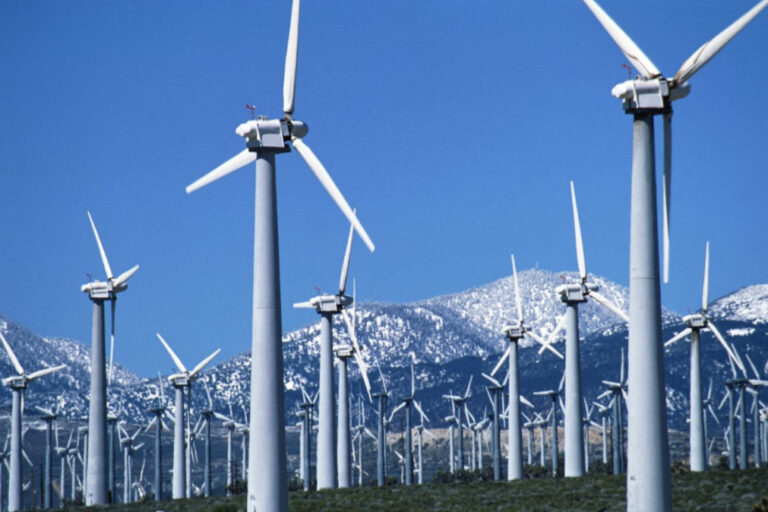 Wind farm with mountains in the background