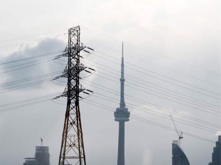 Power lines with the CN Tower in the background